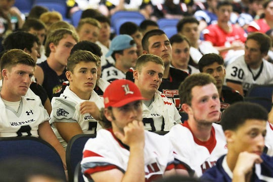 Some of the the players from over 100 northern New Jersey high school football teams that came to the Super Conference Media Day at Wayne Valley on August 15, 2019 listen to Roman Oben, former offensive tackle for the NY Giants and the Super Bowl XXVII winning Tampa Bay Buccaneers and now working for the NFL.