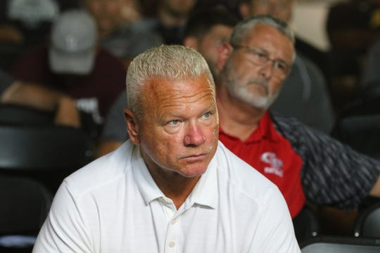Rich Hansen the Super Football Conference President listens to the coaches conference on rules as players and coaches from over 100 northern New Jersey high school football teams that came to the Super Conference Media Day at Wayne Valley on August 15, 2019.