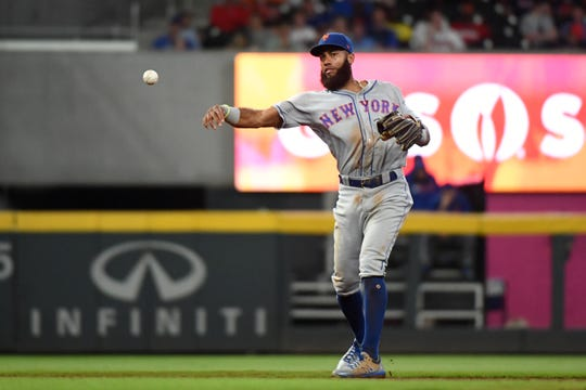 Aug 14, 2019; Cumberland, GA, USA; New York Mets shortstop Amed Rosario (1) throws to first for an out against the Atlanta Braves during the third inning at SunTrust Park. Mandatory Credit: Adam C. Hagy-USA TODAY Sports