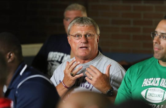 Coach Chuck Johnson of Ridgewood at the coaches conference on rules as players and coaches from over 100 northern New Jersey high school football teams came to the Super Conference Media Day at Wayne Valley on August 15, 2019.