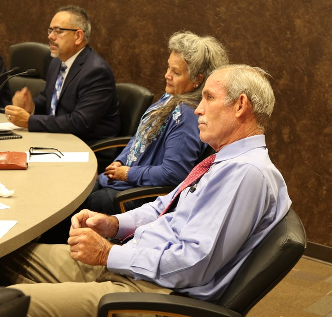 (From left) Carlsbad City Administrator Mike Herandez, Ward 1 City Councilor Lisa Anaya-Flores and Ward 4 City Councilor Mark Waltersceid listen to a presentation during the Aug. 13 Carlsbad City Council meeting.