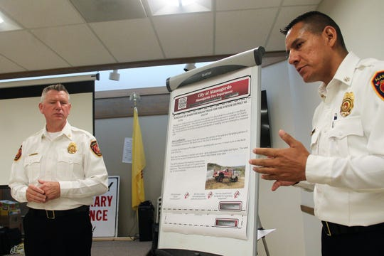 Alamogordo Fire Chief Jim LeClair and Deputy Chief Jerry Ramirez present their ICIP suggestions at a public hearing July 31.