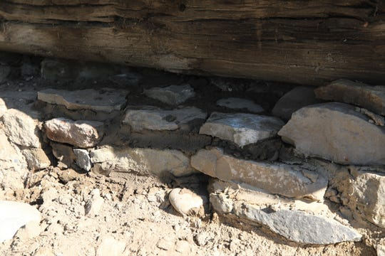 New mortar dries, Thursday, Aug. 15, 2019, on a wall of the root cellar at Salmon Ruins Museum.