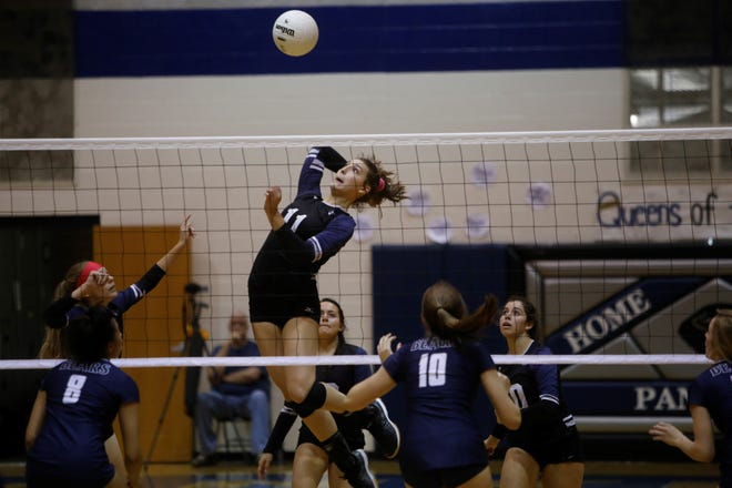 Piedra Vista's Bailey Rasmussen jumps up for a kill against La Cueva during a District 2-5A match on Saturday, Oct. 13, 2018 at Jerry A. Conner Fieldhouse in Farmington.
