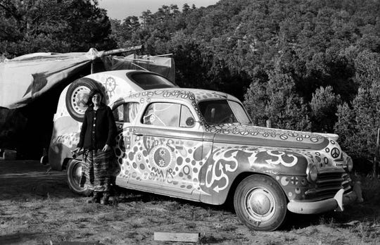 "A woman poses with the ""Humpmobile"" in Libre in the Huerfano Valley in southern Colorado in 1969."