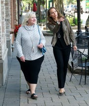 Diane Bauman, left, and Karen Mondora model some fashions from Milford's Clothing Cove on Aug. 15 in the village.