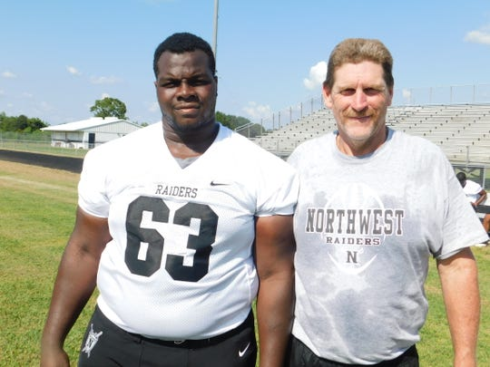 Northwest High senior nose guard Benjamin Eubuomwan and Raiders' assistant coach John Moore will work together this year on a line that is perhaps one of the strongest in St. Landry Parish.