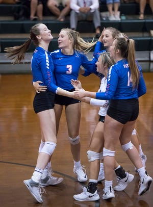 The Patriots celebrate winning a point during the Pace vs Gulf Breeze match in the pre-season volleyball tournament at Catholic High School in Pensacola on Tuesday, August 13, 2019.