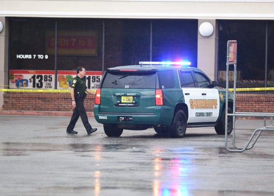 Escambia County Sheriff's Office deputies investigate after a suspect fired shots inside Grocery Advantage off Lillian Highway in Pensacola on Thursday.