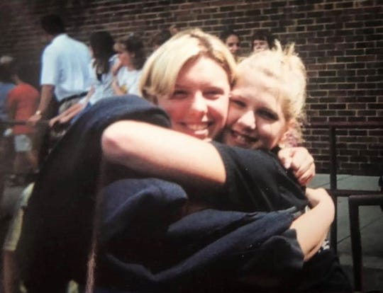 Whitney Utz, left, hugs Nicole Stephanizzi when they were in 8th grade.