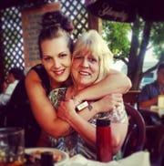 Nicole Stefanizzi hugs her mom Debbie Stefanizzi.