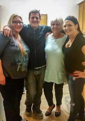 From left to right, Mindy Chiglinsky, Pasquale Stefanizzi, Debbie Stefanizzi and Nicole Stefanizzi pose for a family picture.