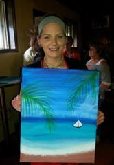 Nicole Stefanizzi poses with her painting.