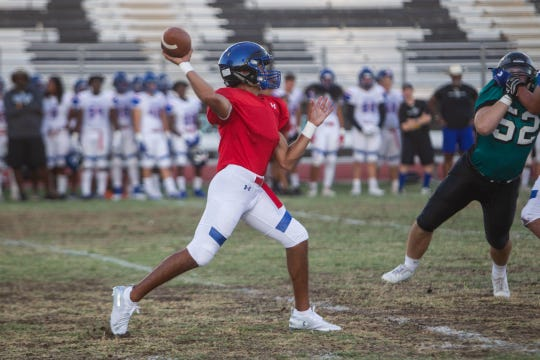 Chandler quarterback Mikey Keene looks to pass during a scrimmage held at Highland High in Gilbert on Aug. 14, 2019.