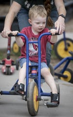 Jackson Snoop (preschool) rides a trike, August 6, 2019, on the playground at St. Dominic Savio Academy, 550 W Warner Road, Chandler.