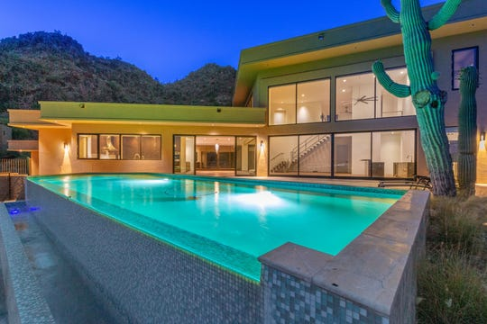 The $2.55 Paradise Valley mansion, sold by Eleanor Androulidakis, features a negative-edge pool and stunning mountain views.