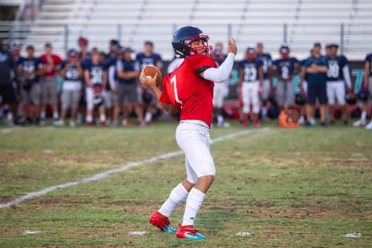 Centennial quarterback Jonathon Morris looks to pass during a scrimmage held at Highland High in Gilbert on Aug. 14, 2019.