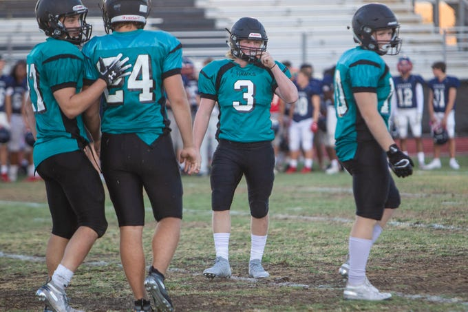 Highland linebacker Kam Cullimore, center, waits on the field with his teammates during a scrimmage held at Highland High in Gilbert on Aug. 14, 2019.