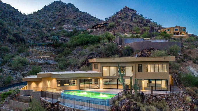 Vance and Holly Joseph paid $2.55 million for this Paradise Valley hillside home surrounded by the Phoenix Mountain Preserve.