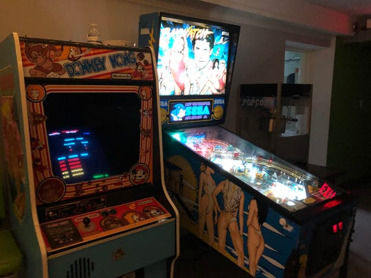 A pinball machine, classic arcade game and popcorn maker are among the fun things hidden in the back of Scott Church's Living Room.