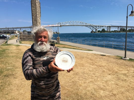 Diver Tim Brown searches the bottom of the St. Clair River for treasures. Earlier this summer, he found this plate, believed to be from the steamboat Mayflower.