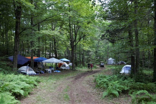 Tents and campsites begin to fill up the wooded acres on Max Yasgur's Farm in Bethel, New York on Thursday, Aug. 15, 2019 to celebrate the 50th anniversary of the Woodstock festival.