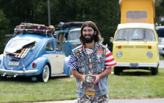 Cornelius Larsen of Frankfurt, Michigan arrives at Bethel Woods Center for the Arts for the 50th anniversary of Woodstock with his 1975 Volkswagen Westfalia camper bus on August 15, 2019.