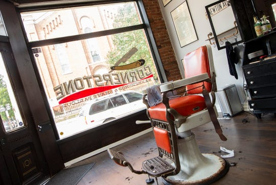 Inside Cornerstone Barbershop in York. The barber chairs were recovered from the Continental Square comfort station in downtown York. The station closed in 1978.