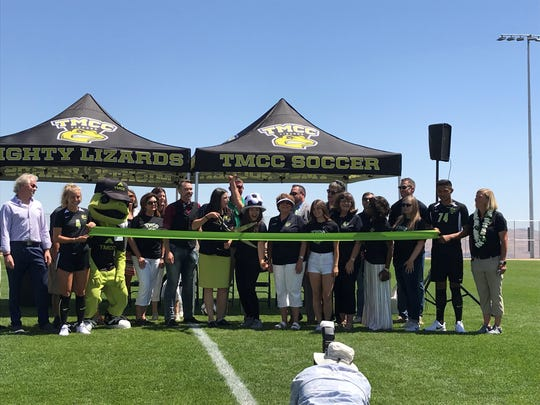 Local officials cut a ribbon on Thursday at TMCC's new soccer field.