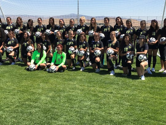 The TMCC women's soccer team poses Thursday on the new soccer field on campus.