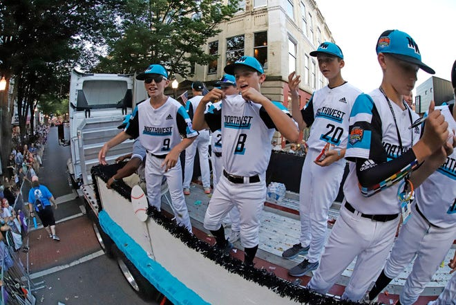 The Northwest Region Champion Little League team from Salem, Ore., rides in the Little League Grand Slam Parade in downtown Williamsport, Pa., Aug. 14, 2019. The Little League World Series baseball tournament, featuring 16 teams from around the world, starts on Thursday in South Williamsport, Pa.