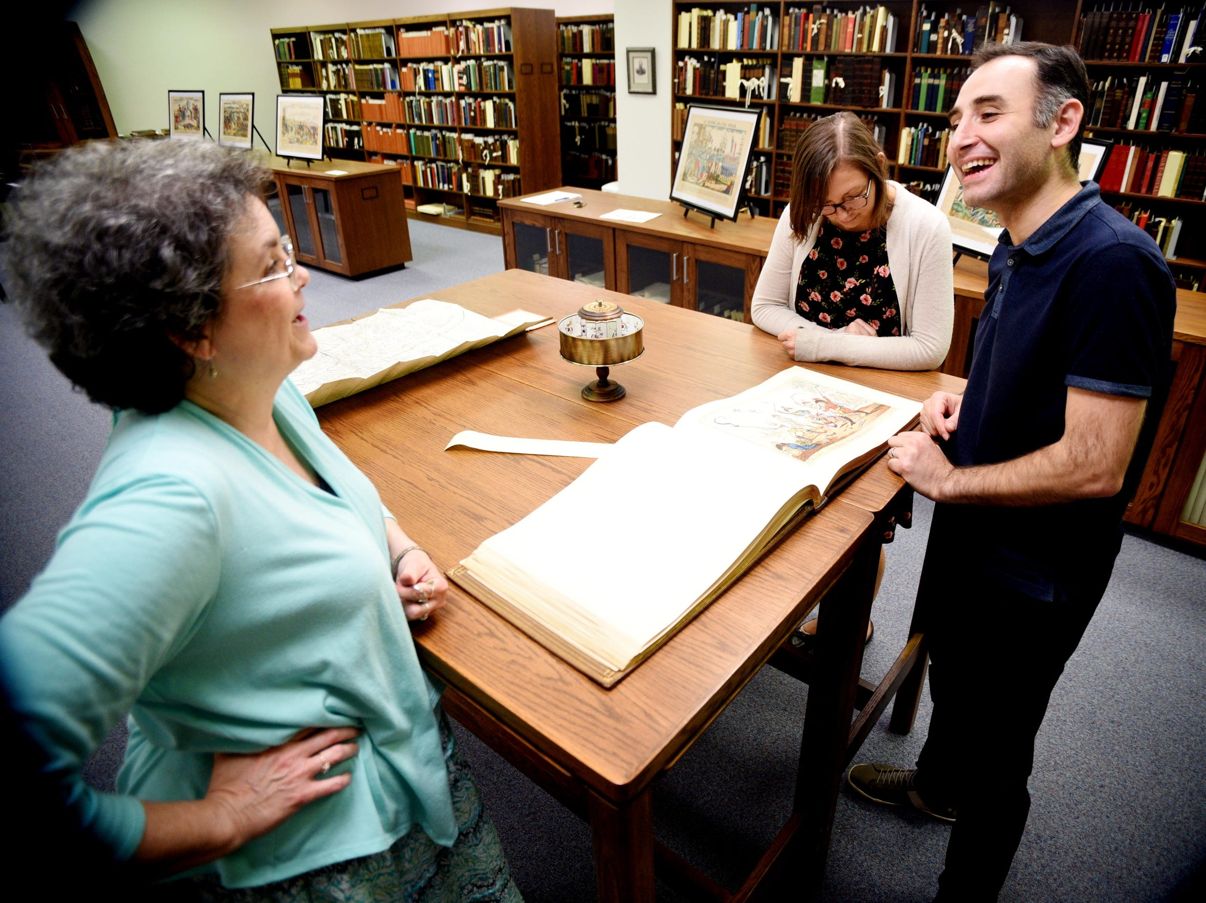 The rare book collection at Noel Memorial Library's staff includes Director Martha Lawler (left), Curator Alexander Mikaberidze (right), and Cataloguers Andrea Schuba.
