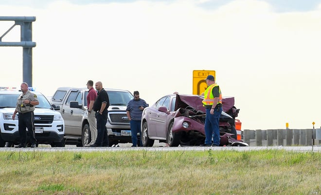 A car involved in a crash on Interstate 90 near the I-229 interchange shows significant damage on Thursday evening, August 15, in Sioux Falls.