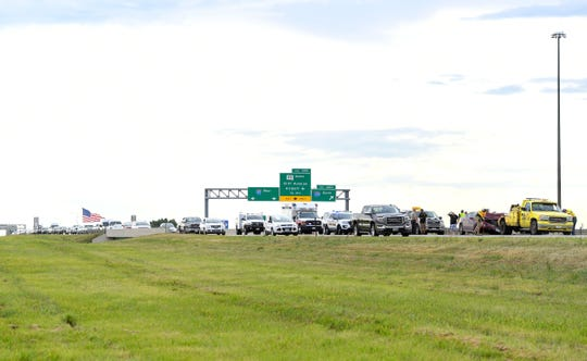 Eastbound traffic on Interstate 90 backs up as it moves past the scene of a car crash near the I-229 interchange on Thursday evening, August 15, in Sioux Falls.