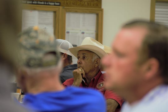 State Rep. Warren Love, R-Osceola, listens at an event focusing on the dangers of industrial farms on Wednesday, Aug. 14, 2019. Love voted for a controversial new law aimed at protecting the farms from local regulations more stringent than those enforced by the state.