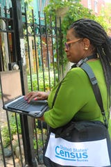 Through Octo. 18, residents may see employees walking the neighborhood with a Census Bureau badge, laptop, and bag as they verify addresses.
