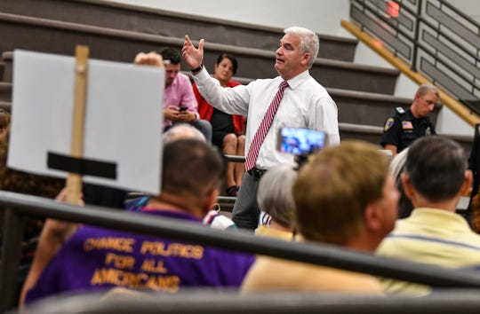 U.S. Rep. Tom Emmer speaks during a town hall meeting Wednesday, Aug. 14, 2019, at St. Cloud City Hall.