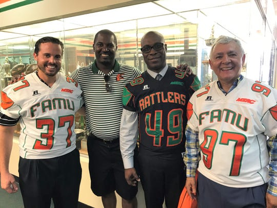 FAMU football head coach Willie Simmons celebrates the sponsorship for the kickoff luncheon and Fan Day with local McDonald's owner Raphael Vazquez (left) along with executives David Ashby, Jr. inside the Galimore-Powell Field House.