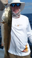 Jimmy Jordon with a 5-pound redfish cught while fishing with guide Junior  Dice.