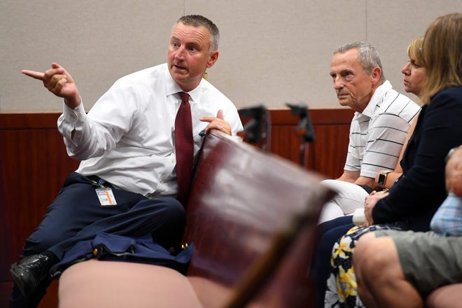 Chief Assistant State Attorney Tom Bakkedahl (from left) speaks with Bill and Lena Andrews, parents of Diana Duve, before a hearing for Duve's accused murderer, Michael Jones, on Thursday, Aug. 15, 2019, at the Indian River County Courthouse in Vero Beach. Jones is accused of fatally strangling Duve in 2014.