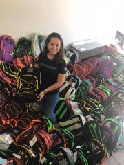 Jessica Parrish packs 303 backpacks with school supplies for Communities Connected for Kids' foster children.