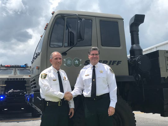 Martin County Sheriff, William Snyder (left) and St. Lucie County Sheriff, Ken Mascara at the Martin County Sheriff's Office. The two agencies will be joining together to help the community if a major storm hits the area.