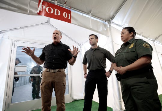 Acting Commissioner of Customs and Border Protection Mark Morgan, left, Acting Secretary of Homeland Security Kevin McAleenan, center, and Interim El Paso Border Patrol Chief Gloria Chavez give a media tour of the new soft-sided migrant holding facility in Tornillo, Texas Thursday, August, 15, 2019. The new center is exclusively for adults; children will continue to be held at the Clint, Texas facility.