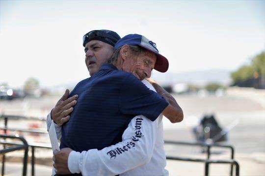 Antonio Basco comforted by Javier Muñoz on Thursday, Aug. 15, 2019, at a memorial near the Walmart near Cielo Vista Mall.