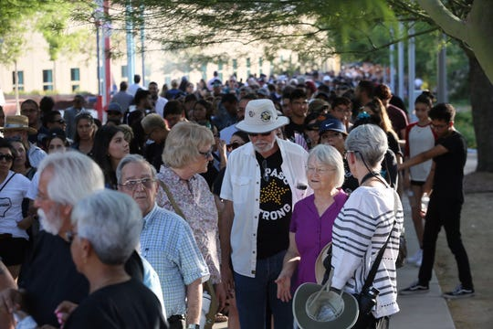 People line up to pay their respects Wednesday, Aug. 14, 2019, at the Community Memorial Service at Southwest University Park for the victims of the Walmart mass shooting.