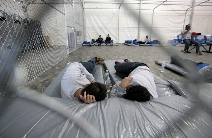 Migrants nap in the new soft-sided migrant holding facility in Tornillo, Texas Thursday, August, 15, 2019. The new center is exclusively for adults; children will continue to be held at the Clint, Texas facility.