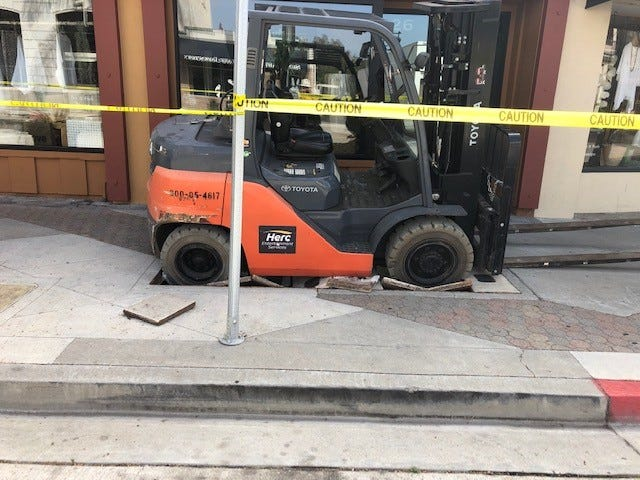 A forklift fell through the sidewalk in downtown Ventura on Thursday and caused a gas line to rupture, according to the city of Ventura Fire Department.