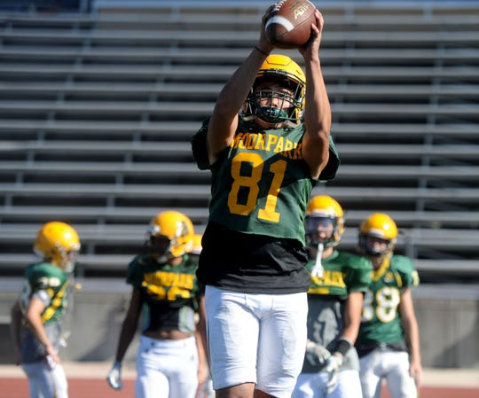 Hunter Milton hauls in a pass during a Moorpark High practice.