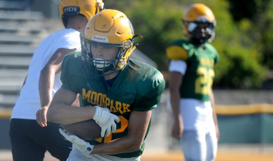 Running back Ethan Gomez takes a handoff during a Moorpark High practice.