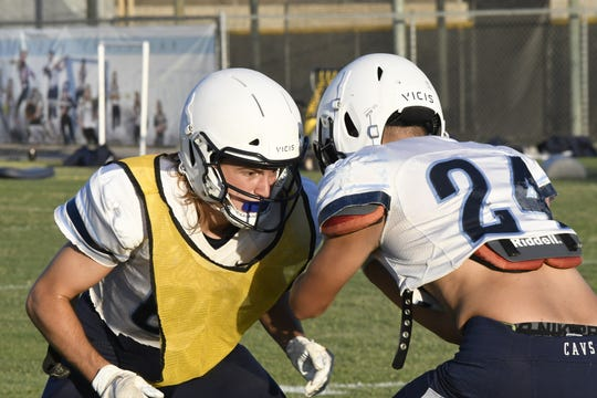 The Central Valley Christian High School football team practices on Aug. 13, 2019 in Visalia.